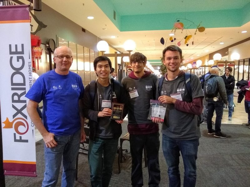 Virginia Tech International Collegiate Programming Contest team members, from left, Yibo Huang, Alex Lind, Benjamin Reidys, and associate professor of computer science Godmar Back.